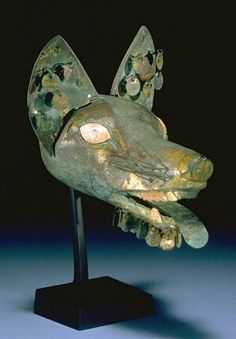 a wonderful example of the artistry of the ancient cultures of the Andes. This fox headdress was made by the Moche people who had a special class of warriors associated with the fox.