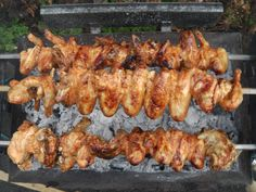 Tasty BBQ Chicken Souvla Cooked Over Hot Charcoals on a Traditional Greek Cypriot Cyprus Barbecue.