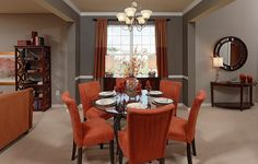 """Transitional Dining Room with Crown molding, Pendant light, Crate & Barrel Halo Ebony Round Dining Table with 60"""" Glass Top"""