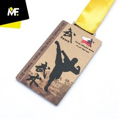 Medal made of metal, imprinted in golden color. A one-sided medal in a rectangular shape, along with dedicated spatially textured graphics, decorated with a color-matched ribbon. It is possible to match the pattern to the customer's needs.  #karate #wushu #martialarts  #sport #event #awards #winners