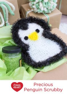 Precious Penguin Scrubby Free Crochet Pattern in Red Heart Yarns -- Whatever the cleaning job, having this little penguin to help makes the time more fun! Crochet it with this shiny version of Scrubby yarn and use it in the kitchen or bath. Of course, it washes by machine and air dries quickly, just like the original Scrubby.