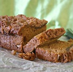 Apple Pumpkin Crumb Bread has two fall flavors in one moist bread! Chunks of fresh apple nestle in a spicy pumpkin loaf. Topped with a sweet, crumbly topping.
