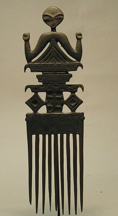 Wooden Hair Comb (Duafe) from Ghana, the Akan peoples, 19th-20th century, in The Metropolitan Museum of Art.