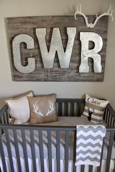 Hunting and Fishing Nursery - love this rustic monogram piece over the crib!
