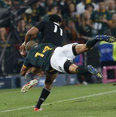 All Blacks' Julian Savea is caught by Cornal Hendricks
