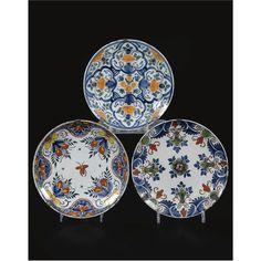 THREE VARIOUS DUTCH DELFT DISHES 18TH CENTURY polychrome painted with floral ornaments Quantity: 3 diameter ca. 22.5cm.