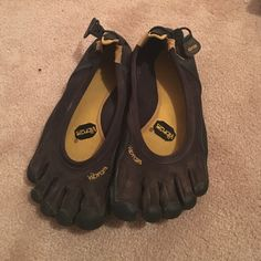 Vibram 5 fingers Super versitile shoes. You can use them swimming (or any kind of water activity) running, biking, anything you want the ultimate barefoot ride for. Or just wear them around because they look cool. The bottoms say 38 but they fit a 6.5-7 Vibram Shoes Athletic Shoes