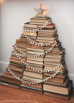 "A Dozen Favorite Creative Christmas Decorating Ideas! – Kelly Elko A Dozen Favorite Creative Christmas Decorating Ideas! Cute stacked Christmas book tree complete with shining star! One of a dozen creative Christmas ""trees"" eclecticallyvinta… Book Christmas Tree, Creative Christmas Trees, Book Tree, Decoration Christmas, Winter Christmas, All Things Christmas, Christmas Holidays, Christmas Crafts, Merry Christmas"