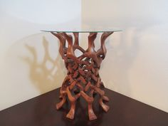 """Middle Eastern RoseWood Puzzle Wood End Table $250.00  This simple wood stand explores a whole different world of woodworking. This puzzle concept design keeps this intricate look of the wood simple and yet so stunning in its adversity. 20 3/8"""" H x 19 1/4"""" DIA https://squareup.com/market/our-sister-company/middle-eastern-rosewood-puzzle-wood-end-table"""