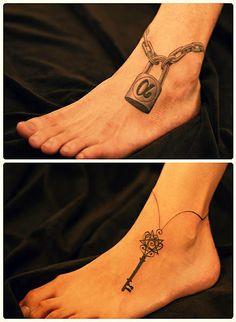 A matching lock and key tattoo