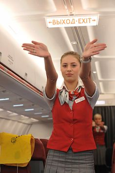 More attractive female airline crew, ground staff and flight attendants wearing uniforms with very tight skirts: . Corporate Uniforms, Airline Uniforms, Tight Pencil Skirt, Tight Skirts, Come Fly With Me, Go Online, Beautiful Young Lady, Military Women, Girls Uniforms