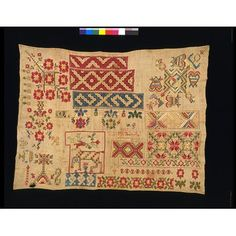 Anastasia Anrrigues 1826, born 1800.  Mexican sampler linen ground, silk embroidery in back, long-armed, cross, satin stitch with drawn thread work. Spanish samplers traditionally included the areas of geometric pattern you can see on this Mexican sampler of 1826.