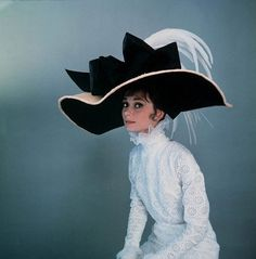 """Audrey Hepburn models the costumes of """"My Fair Lady"""" for both photographer & costume designer for the film Cecil Beaton."""