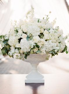 Gorgeous White on White (with greenery) Centerpiece