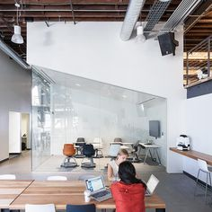 "<p>The ""war room"" is designed for power-working sessions on deadline. Desks allow designers and engineers to work shoulder-to-shoulder on their laptops and then feverishly cover the whiteboard and glass walls with their brainstorming notes.</p>"