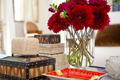WSH♥ loves the perfect coffee table vignette: boxes, interest object, candlelight and flowers. Via Mark D. Sikes.