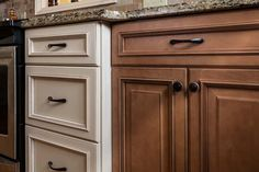 Looking to mix things up in your space? Try a two-toned #kitchen! Our Wellington cabinets in Spice and Ivory are timeless and beautiful. #ThinkFabuwood   Kitchen built by 75 Cabinets ( http://www.75cabinets.com/)