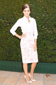 Classic white blouse with printed pencil skirt. And lovin those heels.