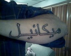 arabic tattoos on hand