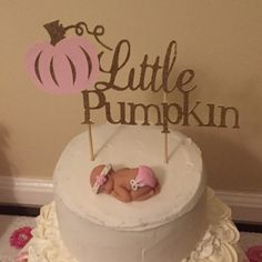 Photo from a customer of one of our baby cake toppers on display - love it!! athreadrunsthruit.etsy.com
