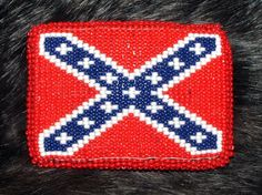 """Rebel flag belt buckle measures 3.5 x 2.5"""" Loom woven beadwork securely sewn over a sturdy cast metal belt buckle onto a leather backing. Native American made. #beadwork #rebelflag #beltbuckle"""