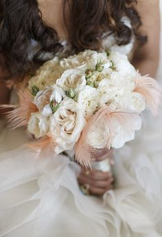 Beehive creates pink feathers mixed with white and green florals for this glam affair.