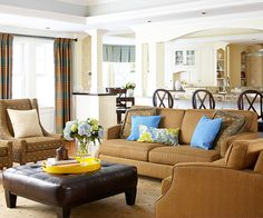 We love the decorating duo of brown and blue in this space. More inspiring living rooms: http://www.bhg.com/rooms/living-room/makeovers/living-room-decorating-ideas/