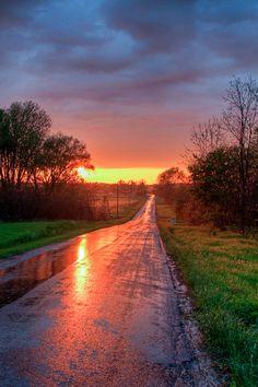 Setting sun lights up a country road after a rainstorm (Skaneateles, New York) by Matt Champlin cr.c.