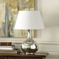 This large Gourd Lamp is handmade of antiqued mouth-blown glass and stainless steel. Shop Ballard Designs today.