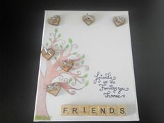 Hand painted watercolour canvas with pyrographed hearts and scrabble tiles friends