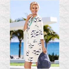 "New Listing Beaded Fish Tunic Adorable navy colored fish with turquoise beading! Great to wear to the beach! Has a slight stain on the back which is documented in the third picture. Trades Holds The bust is 42"" and the length is 35"". 100% Linen. Talbots Swim Coverups"