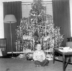 Christmas as a little girl with all the icicles on the tree!