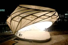 """From the Fabric Structures Association website: """"Fabric structures are characterized by having a rather small mass relative to the applied load, which is determined through an optimization process. The types of structures that FSA focuses on include air-inflated, air-supported, cable net, frame-supported, geodesic dome, grid shell, tensegrity (cable-and-strut) and tensile (or tension) structures."""""""