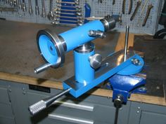 Ball Turning Jig by c.phili -- Homemade ball turning jig machined from steel and intended to facilitate the production of neatly proportioned spheres from wooden stock. During operation, the jig's mounting flange is fixed in a bench vise. Features an adjustable cutting depth. http://www.homemadetools.net/homemade-ball-turning-jig