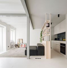 Completed in 2019 in Lisboa, Portugal. Images by DC. RGM 46 duplex apartment is a refurbishment project located in Lisbon, with an area of approximately with a small terrace on the roof. Duplex Apartment, Apartment Renovation, Apartment Interior, Studio Apartment, Living Area, Living Spaces, Living Room, Metal Shelving Units, Small Terrace