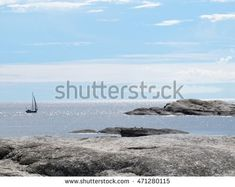 A sense of freedom. Beautiful sailboat sailing sail on the blue open sea spaces in Norway. Rocky shore in the foreground. Ocean Horizon, Rocky Shore, Sailboat, Norway, Sailing, Photo Editing, Freedom, Royalty Free Stock Photos, Sea