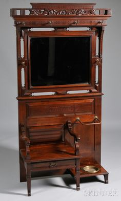 Victorian Aesthetic Movement Mirrored Carved Walnut Hall Tree, with beveled glass and original brass hardware.