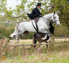 Jess Cherriman jumping side saddle during the Opening Meet of the Quorn Hunt at the Kennels, Kirby Bellars, Friday October