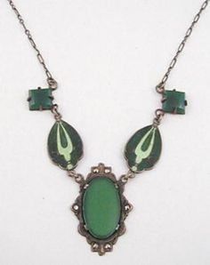 Hycrest 1920's Art Deco sterling necklace, a delicate piece with a deep green glass flat oval stone in a frame decorated with marcasites and connected to light and dark green enameled links which are in turn connected to square green glass stones on a thin sterling chain.