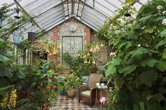 Victorian conservatory filled with plants Robert Kime decorating