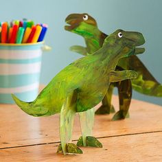 Show four-legged dinosaurs who's boss with this cleverly designed bipedal model. Download our template below, trace the shapes on cereal box cardboard, and cut them out. Paint both sides of the pieces and let them dry, then slot them together.