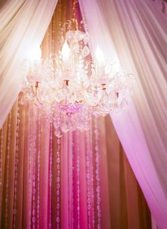 A wonderful detailed chandlier hangs in front of this chiffon overlay We love this! Our Love, Overlays, Floral Design, Chiffon, Chandelier, Ceiling Lights, Flowers, Home Decor, Silk Fabric