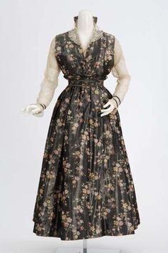 Circa 1915 Gray printed silk dress trimmed with lace. Made by dressmaker Elizabeth Esler, Minneapolis, Minnesota.