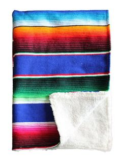 The perfect combination of style and utility. Each blanket is hand made with a Mexican serape blanket on one side and a super soft sherpa material on the other.