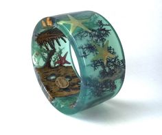 A personal favorite from my Etsy shop https://www.etsy.com/listing/268996176/bracelet-sz-small-nature-ocean-art