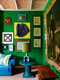 The most beautiful gallery walls from the pages of Vogue Living: Artworks against a striking green wall in the home office of Jean Philippe Demeyer's home in Belgium. Image: Kasia Gatkowska