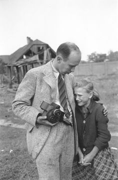Photographer Julien Bryan comforts a ten-year-old Polish girl named Kazimiera Mika, whose older sister was killed in a field near Jana Ostroroga Street in Warsaw during a German air raid by Luftwaffe (September WWII Nagasaki, Hiroshima, Fukushima, Historia Universal, Vietnam, Religion, Interesting History, History Facts, World History