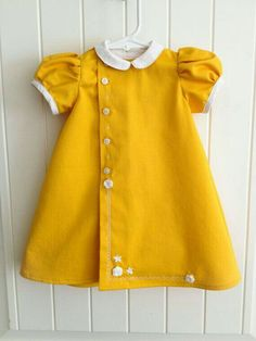 Items similar to One of a Kind Mustard Yellow Baby Dress-Ready to ship on Etsy - Mustard dress for a baby girl by Custom Creations Mandy on Etsy. Frocks For Girls, Little Girl Dresses, Little Girl Fashion, Kids Fashion, Baby Yellow, Baby Sewing, Toddler Dress, Infant Toddler, Girl Outfits
