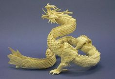 Ryu Jin de Satoshi Kamiya. Believe it or not, it's made from just one square sheet of paper. Just folds. No glue.