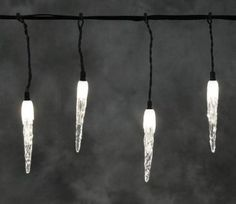 Konstsmide 24V LED System 50 Acrylic Icicle Set black cable. Hanging off a black cable, these icicles will appear to magically float beneath your roofline.